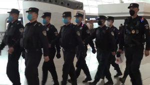Policemen_wearing_masks_patrolling_Wuhan_Tianhe_Airport_during_Wuhan_coronavirus_outbreak
